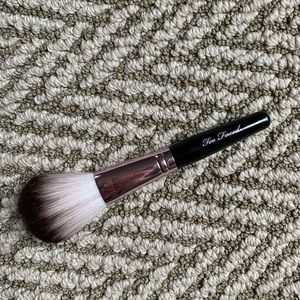 Small Too Faced teddy bear hair powder brush